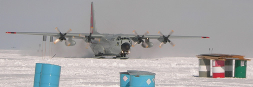 A New York Air National Guard Hercules LC-130H arrives on the apron at NEEM camp.