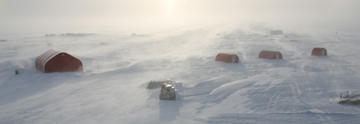 Drifting snow in camp. Where does the ice end and where does the sky begin?