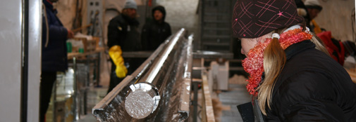 A freshly drilled ice core sticks out from the bottom of the drill. Krissy