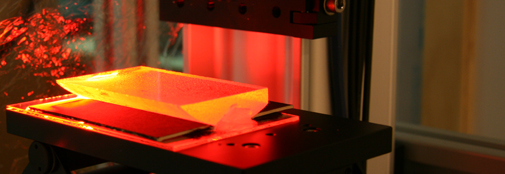 A slice of ice core is being micro scanned in red light for bubble shape