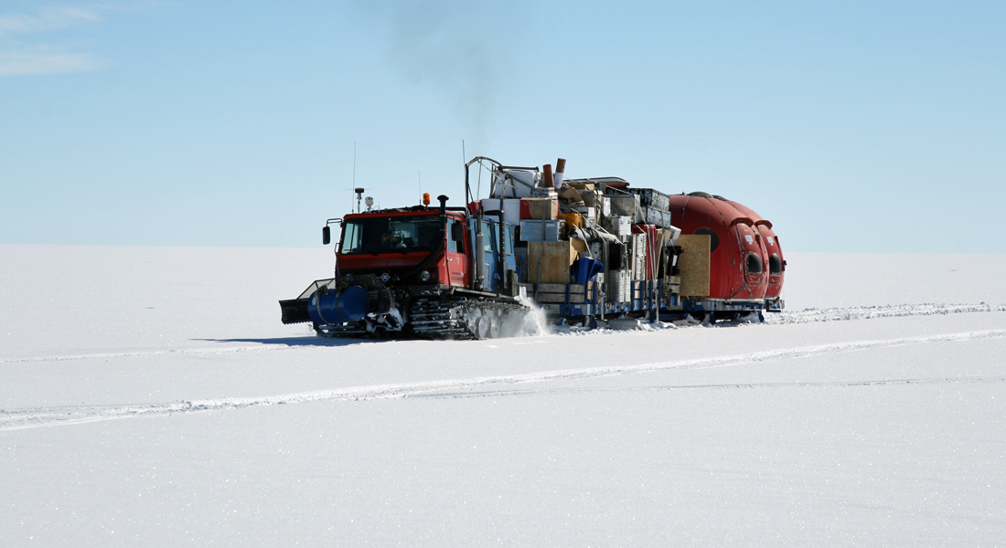 Traverse vehicle train moving cargo from the former NGRIP camp to the NEEM site